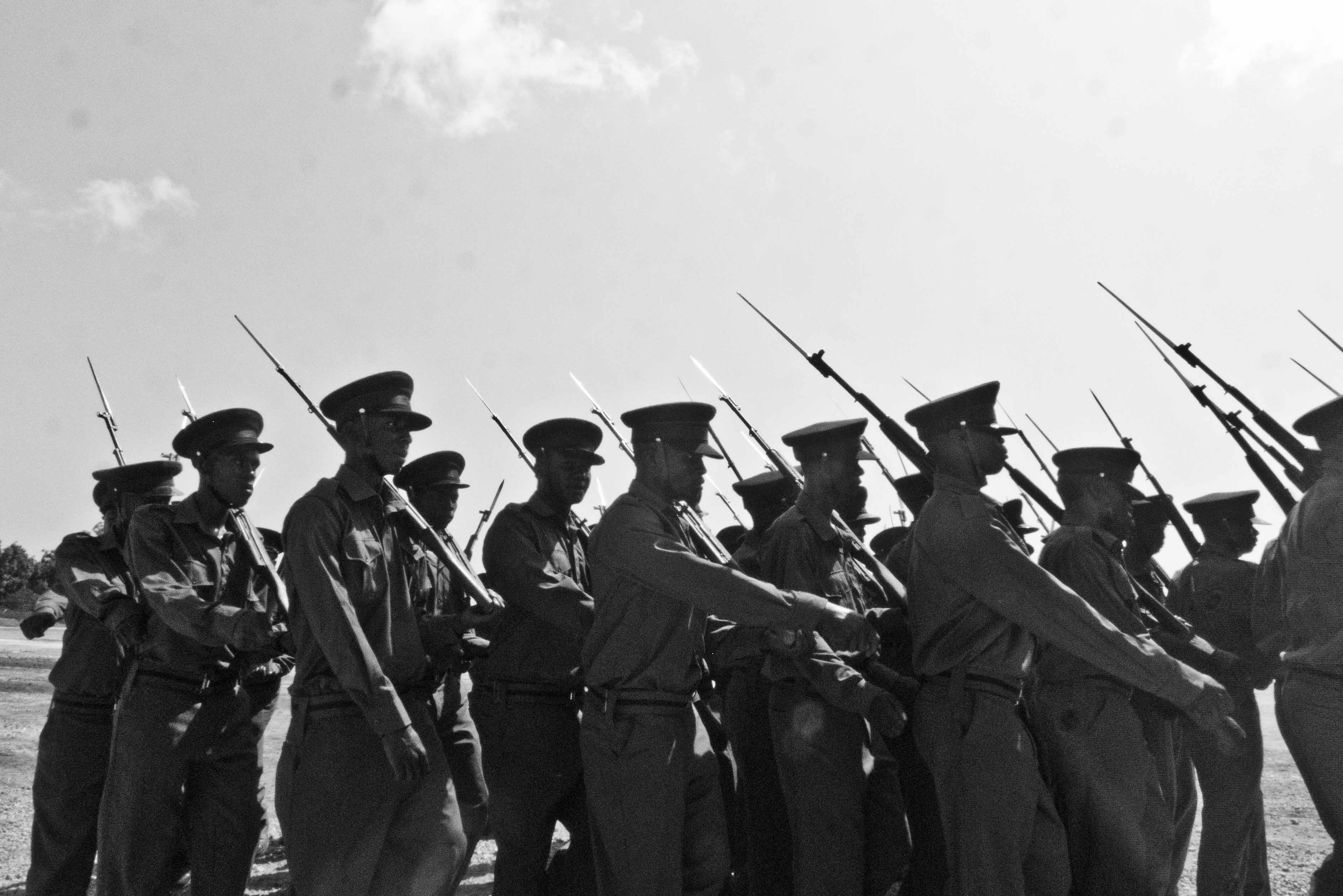 Silhouettes of soldiers marching