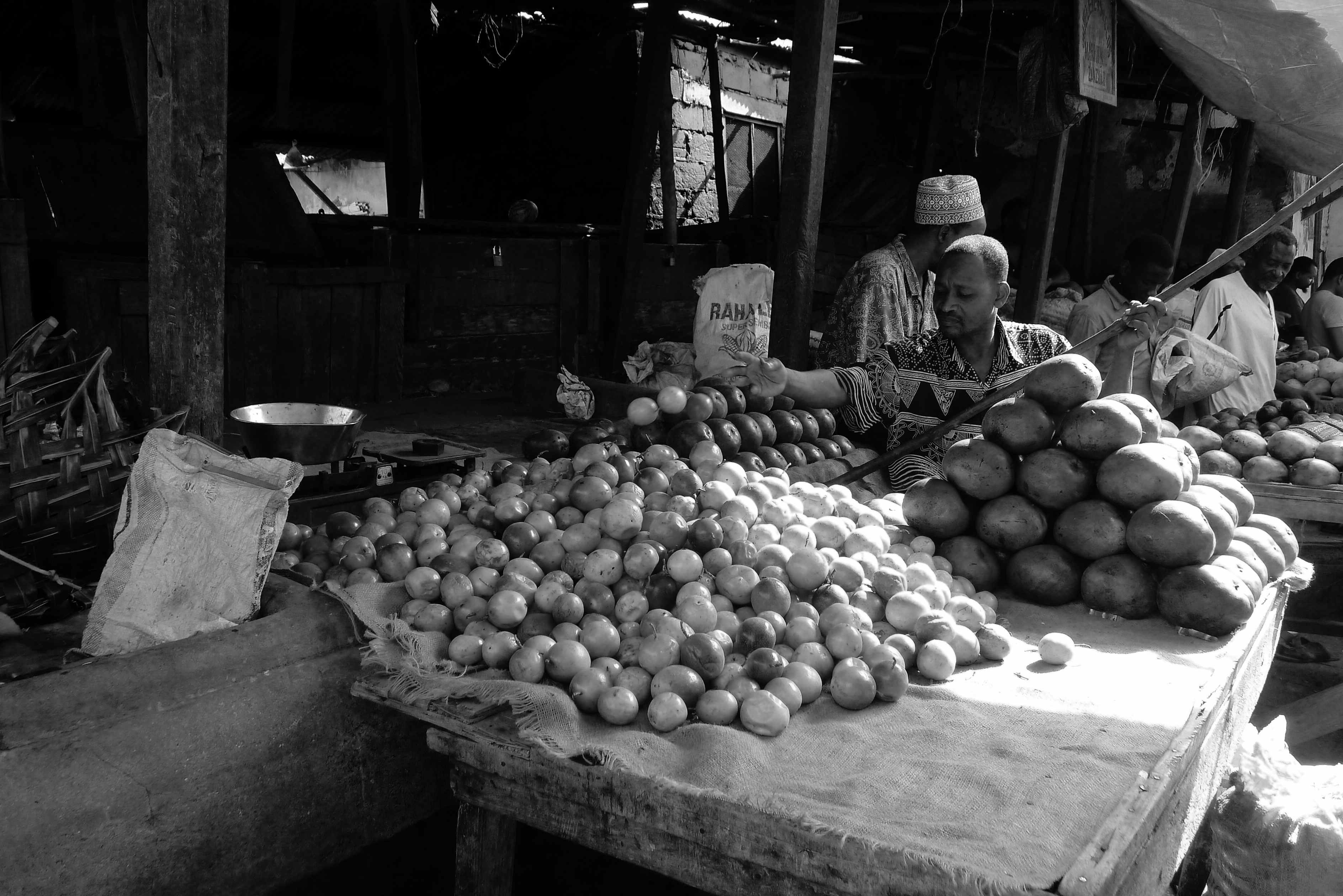 Man selling passion fruits, Stone Town