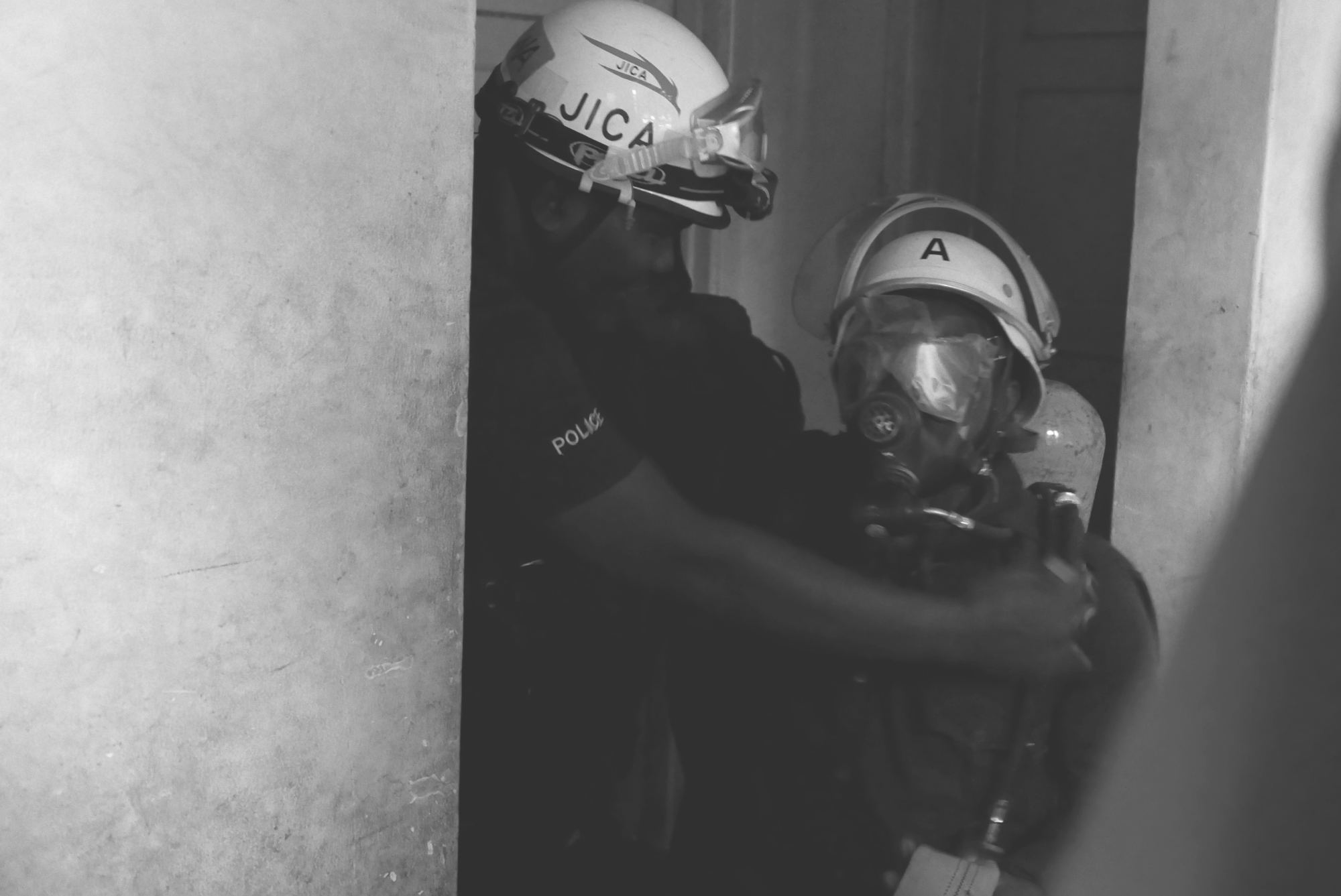 Instructing blindfolded firefighter